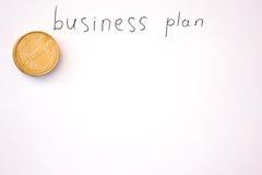 Inscripción del plan empresarial con las monedas Foto de archivo