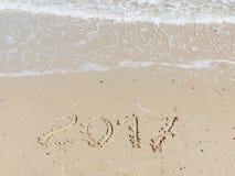 inscripción 2017 en la arena amarilla Imagen de archivo