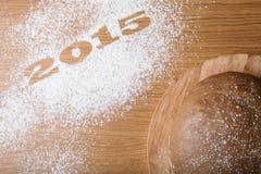 Inscripción 2015 en la harina y la pasta en una tabla de madera Foto de archivo libre de regalías