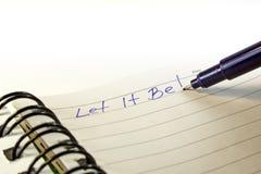 Inscripción en un cuaderno. Foto de archivo