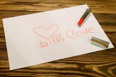 Inscripción roja del lápiz labial con amor Fotos de archivo libres de regalías