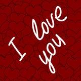 Inscripción te amo y muchos corazones rojos Fotos de archivo