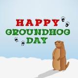 Inscripción feliz del día de la marmota en fondo azul Personaje de dibujos animados de Groundhog que mira su sombra Fotos de archivo