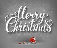 Inscripción y Santa Claus de la Feliz Navidad con los regalos Imagen de archivo libre de regalías