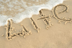 Inscription. Life on sand. Sea coast with a rolling wave on an Stock Image