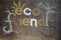 Inscription amicale d'Eco et décoré en graines Images stock