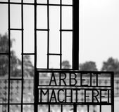 Inscription ARBEIT MACHT FREI. SACHSENHAUSEN ORANIENBURG, GERMANY 05 21 10: Inscription ARBEIT MACHT FREI  `work sets you free` on the gates to the former Nazi Royalty Free Stock Photography