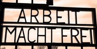 Inscription ARBEIT MACHT FREI. SACHSENHAUSEN ORANIENBURG, GERMANY 05 21 10: Inscription ARBEIT MACHT FREI  `work sets you free` on the gates to the former Nazi Royalty Free Stock Images