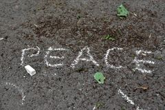 Inscription on asphalt with white chalk: peace Royalty Free Stock Images