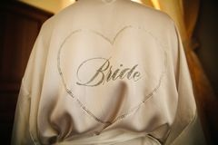 The inscription on the back of the girl from rhinestones - the bride. Close-up royalty free stock images