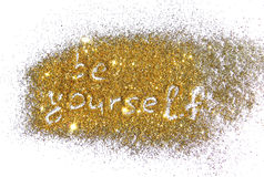 Inscription Be Yourself on golden glitter sparkle on white background. Inscription Be Yourself on golden glitter sparkle on white stock images