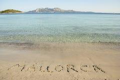 Inscription on the beach. Of Mediterranean sea, Mallorca, Spain Stock Photos