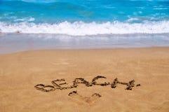 Inscription beach on the sand. Beach season. Rest on the sea Royalty Free Stock Photo