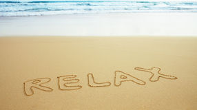 Inscription on beach sand - relax Stock Image