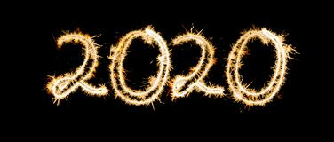 Inscription 2020 from Bengal lights. New Year`s and Christmas concept. On a black background Banner stock photography