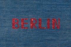 Inscription Berlin, inlaid rhinestones on denim. Stock Photo