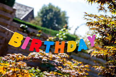 Inscription Birthday by separate colored letters Stock Photography