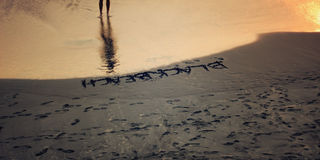 The inscription 'Black beach' on the black sand of small beach ii Varkala. Royalty Free Stock Photography