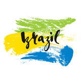 Inscription Brazil, background colors of the Brazilian flag. Stock Photo