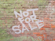 Inscription on brick wall - not for sale. Inscription on a brick wall - not for sale stock photos