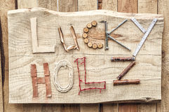 The inscription of the building materials at hand. 'lucky Holz' from the German 'lucky tree Stock Photography