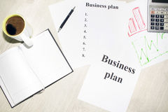 An inscription of the business plan, execution points, there is a notebook and a calculator next to it.  royalty free stock photo