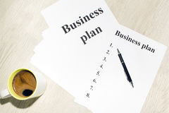 An inscription of the business plan, execution points, there is a notebook and a calculator next to it.  stock photos