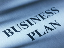 The inscription business plan on a sheet of paper. Stock Image