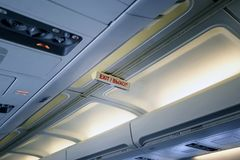 The inscription in the cabin of the airplane. Royalty Free Stock Image