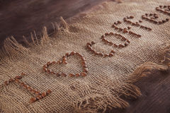 Inscription on the canvas, I love coffee, close-up.  Royalty Free Stock Photos