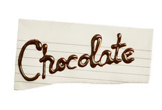 Inscription chocolate on a piece of paper. For you design stock photo