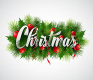 Inscription Christmas with fir branches and holly Royalty Free Stock Image