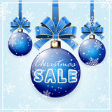 Inscription Christmas Sale on blue ball Stock Photography