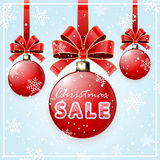 Inscription Christmas Sale on red ball Royalty Free Stock Photography