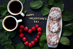 Inscription Closeup of Valentine`s day, cherry, muffins, coffee Royalty Free Stock Photography
