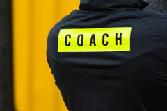 The inscription on the coach sports jacket stock image