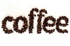 The inscription of the coffee beans надпись из кофейных зёрен royalty free stock photo