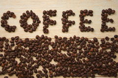 Inscription of coffee beans arranged in the word coffee stock images