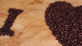 Inscription from coffee beans. Heart of coffee beans. The inscription I love coffee. On the kitchen table. stock footage