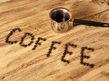 Inscription coffee beans Stock Images