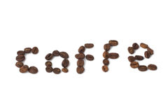 Inscription of coffee from coffee beans Stock Photos