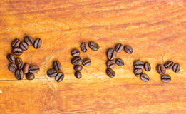 Inscription coffee from coffee beans. Stock Photos