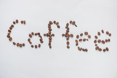 Inscription. Coffee from coffee grains on a white background stock image