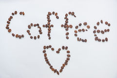 Inscription. Coffee from coffee grains on a white background royalty free stock image