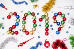 The inscription is composed of the 2019 new year colorful balloons and other toys on white background. Top view stock image