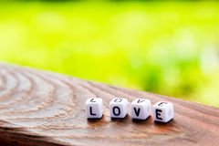 The inscription of the cubes love on wooden table Royalty Free Stock Photos