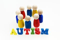 Inscription d'autisme avec des chiffres et sur le fond blanc Photos stock