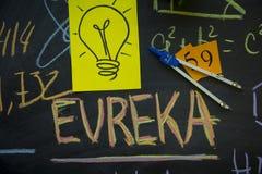 Inscription d'Eureka sur un tableau noir photographie stock