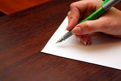 Inscription d'une lettre Photo stock