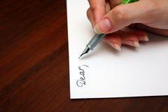Inscription d'une lettre Photo libre de droits